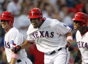 ARLINGTON, TX - MAY 13: Nelson Cruz #17 of the Texas Rangers celebrates with teammates Michael Young #10 and Adrian Beltre #29 after hitting a grand slam home run against pitcher Jered Weaver of the Los Angeles Angels on May 13, 2012 in Arlington, Texas. (Photo by Layne Murdoch/Getty Images)